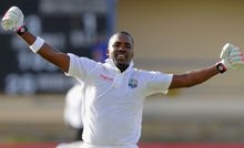 The West Indies batsman Darren Bravo celebrates.