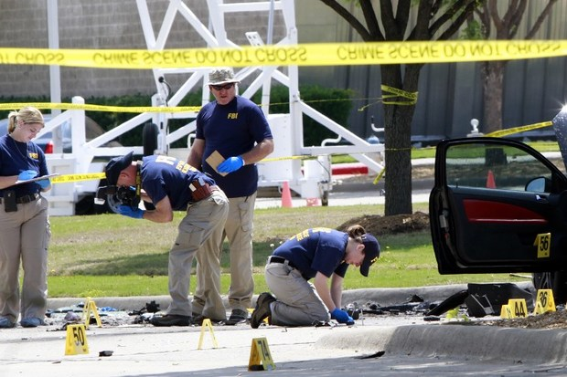 The crime scene before the removal two bodies outside of the Curtis Culwell Center in Garland.