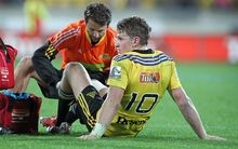 Hurricanes first five Beauden Barrett gets treatment for his injured knee.