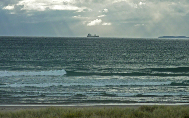 Ship cruising south past Mount Maunganui.