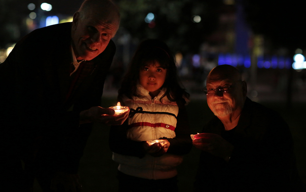 Candlelight vigil for Nepal. Peter Hillary, Rosalynne Basnet and Sir Ray Avery.