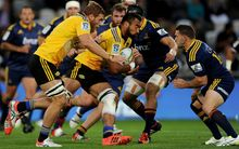 Hurricanes number eight Victor Vito on the charge against the Highlanders.