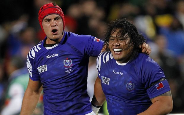 Daniel Leo (L) and Census Johnston playing for Manu Samoa at the 2011 Rugby World Cup.