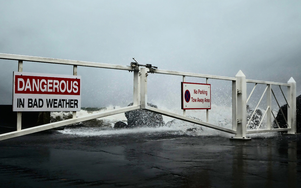 Waves crash over the breakwater at Port Taranaki.