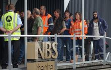 Workers attend today's meeting at the Stockton mine.
