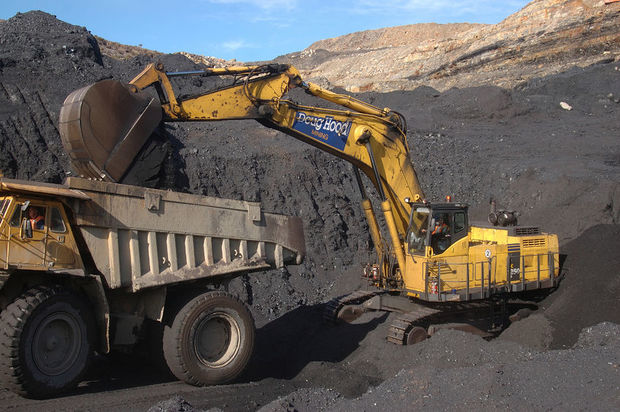 Digger loads up a truck at Stockton Coal Mine.