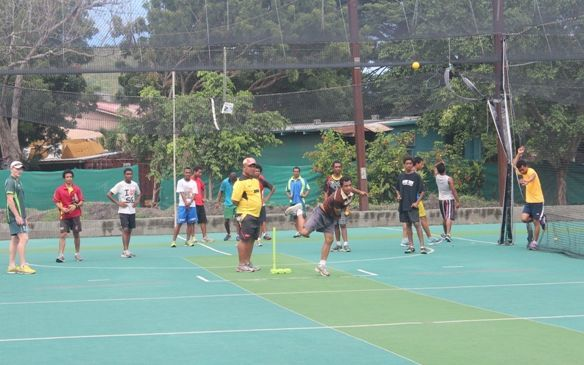Young cricketers are put through their paces at a training session in Papua New Guinea.