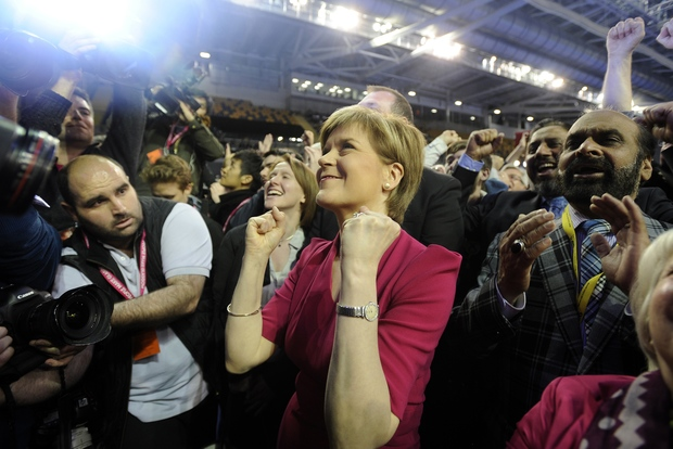 SNP leader Nicola Sturgeon (C) celebrates as election results are announced - with the party taking 56 out of 59 seats in Scotland.