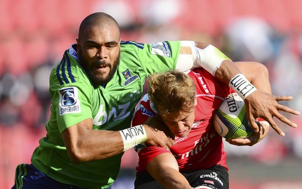 Andries Coetzee of the Lions tackled by Patrick Osborne of the Highlanders.