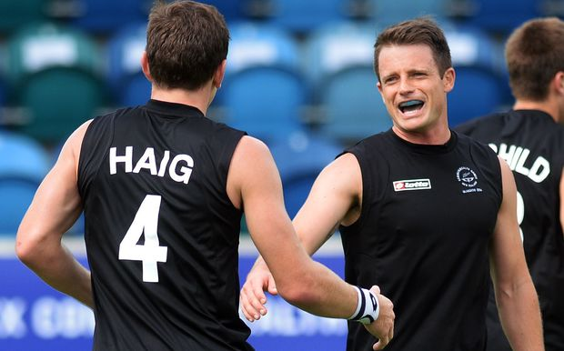 Nick Haig celebrates a goal with his New Zealand team-mate Shea McAleese.