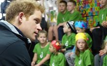 Prince Harry with children at Halfmoon Bay School.