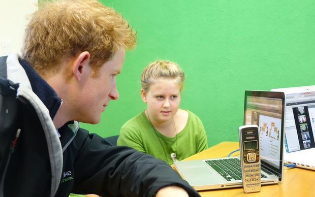 Prince Harry with students at Halfmoon Bay School using remote learning technology.