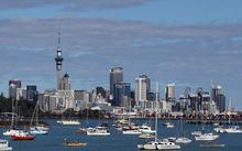 Boats moored in waters in front of the Auckland city skyline: February 2014