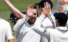 Spinner Mark Craig celebrates taking a wicket with his New Zealand team-mates.