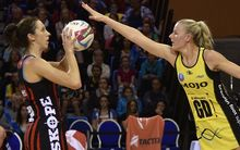 The Tactix Bailey Mes looks to shoot with the Pulse captain Katrina Grant in defence.