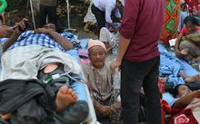 Nepalese patients lie on stretchers following the quake.