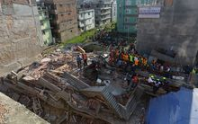 Rescue teams search for survivors at a collapsed building in Kathmandu.