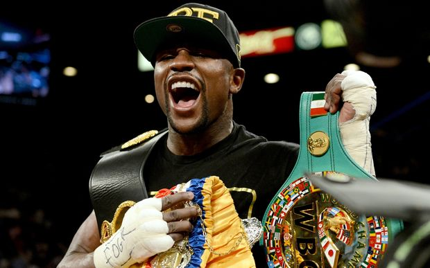The American boxer Floyd Mayweather with title belts.