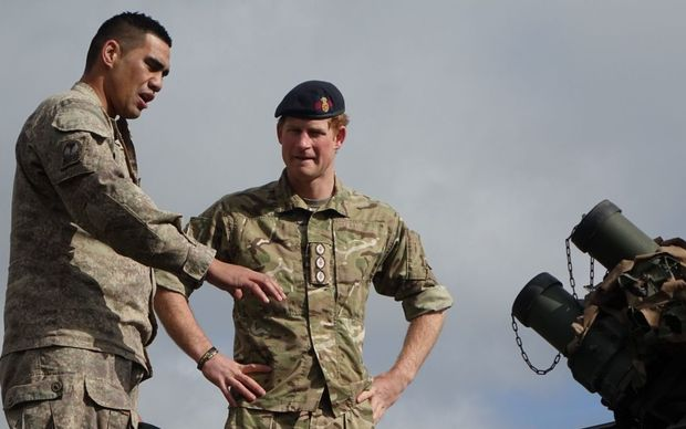 Corporal Poi talks Prince Harry through the intricacies of a LAV before taking him for a spin.