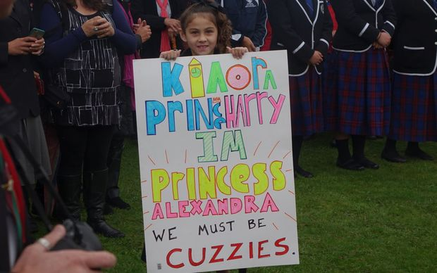 We girl with cuzzies sign for Prince Harry