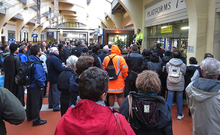 Commuters wait in vain for news at Wellington Railway Station.