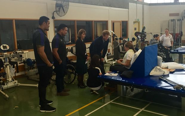 Kevin Mealamu and Jerome Kaino join Prince Harry to meet with current patients.