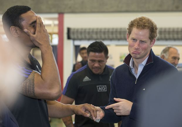 Prince Harry commiserates Jerome Kaino's injury, centre is Keven Mealamu.