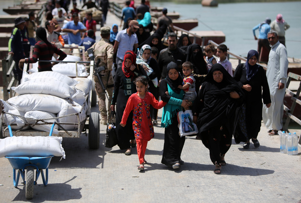 Displaced Sunni Iraqis, who fled the violence in Ramadi, arrive at the outskirts of Baghdad in April 2015.