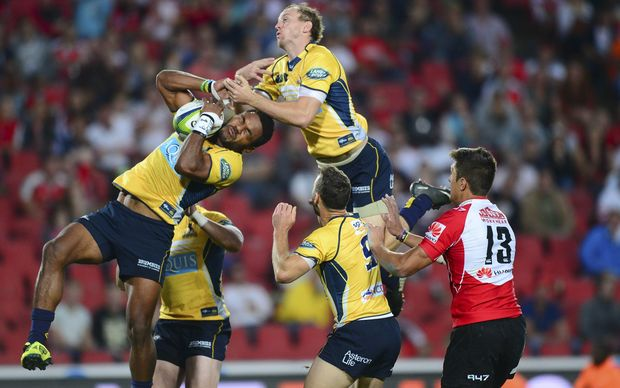 Joe Tomane and Jesse Mogg of the Brumbies take to the sky against he Lions, 2015.