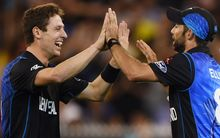 New Zealand's Matt Henry and Grant Elliott celebrate a wicket during the Cricket World Cup Final.