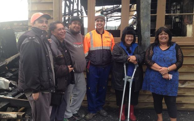 The Tautoko FM crew following the fire.