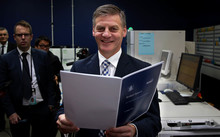 Bill English picking up the Budget at the printery in Petone, Lower Hutt.