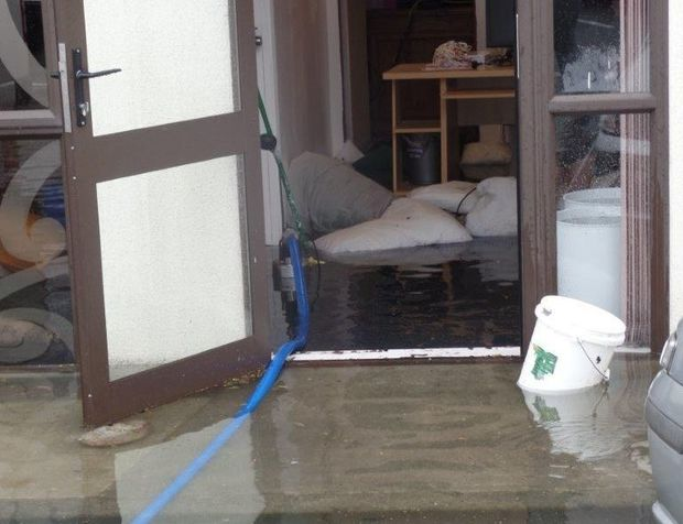 Bedding was used as sandbags to try to to stop the floodwater.