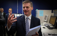 Bill English holding the 2015 Budget in Petone, Lower Hutt.
