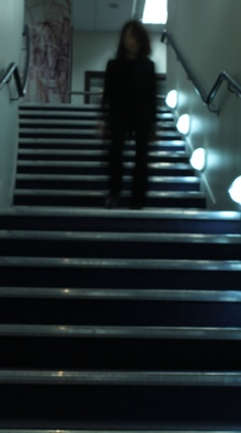 'Get up out of your chair and regularly walk along the corridor or up and down the stairs' - that's the advice from researchers who say spending too much time sitting is bad for our health. Photo of person walking down the stairs.