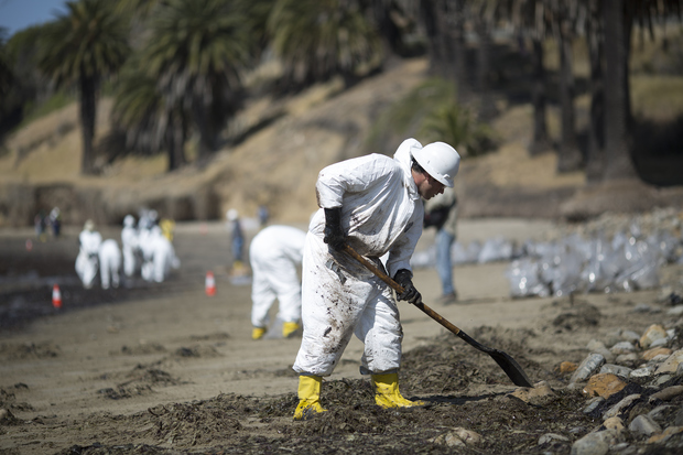 Crews clean oil from the beach at Refugio State Beach.