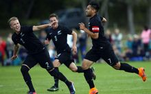 Bill Tuiloma (R) and team-mates celebrate his opening goal