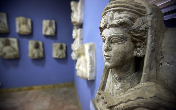Statues and artifacts at Palmyra's museum. Hundreds of treasures have been moved to Damascus to protect them.