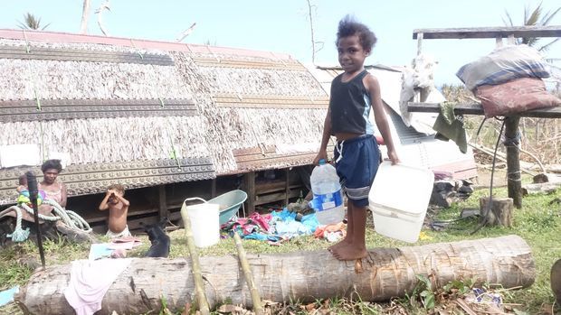 This little girl was sent by her mother to get some of the clean water being delivered for her baby sister.