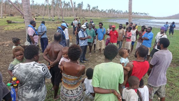 Villagers in South Epi who had been waiting for a week and a half at this point without receiving relief aid listen to Prime Minister Joe Natuman's reassurances that aid is on its way.