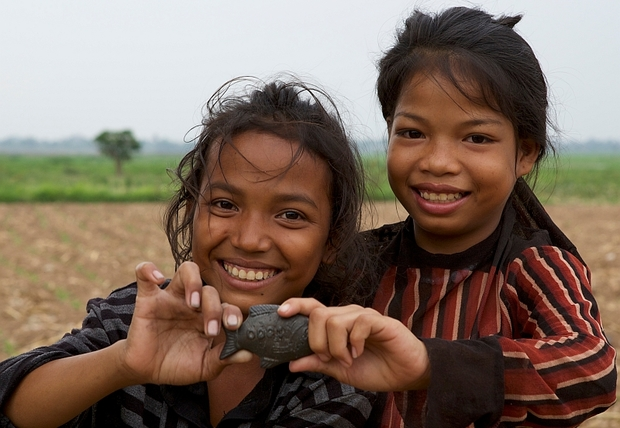 Children in Cambodia with an Iron Fish.