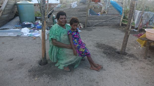 A widow and her granddaughter, in front of what used to be their home, Shepherd Islands.