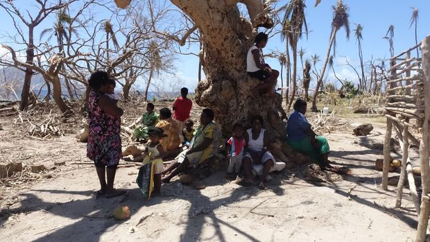 Women seek refuge from the scorching sun. With no leaves on the trees and no roofs on their houses, exposure to the elements was a major concern.
