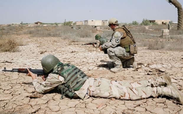 A New Zealand Defence Force trainer instructs ISF soldiers in correct weapons firing positions. Iraq - 2015