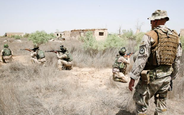 A New Zealand Defence Force trainer instructs ISF soldiers in correct weapons firing positions. Iraq 2015