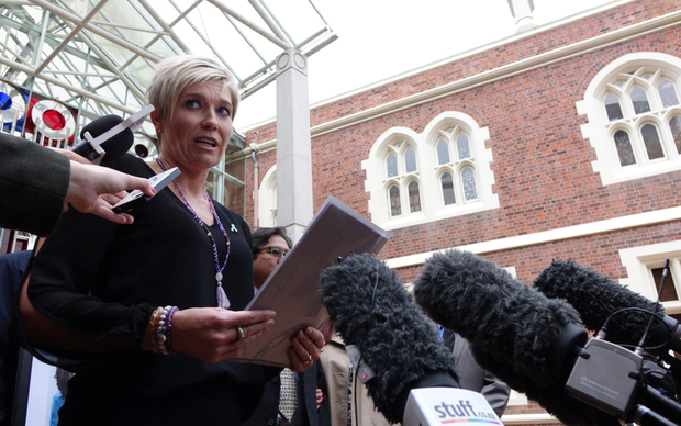Family spokesperson Ruth Money speaking to media outside the High Court in Auckland.