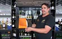Barman Tane Rogers, of Te Arawa. At Karaka Cafe, staff kōrero in Te Reo and it is included on the menu and on store signage.