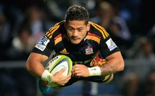 Augustine Pulu dives in for a try for the Chiefs.