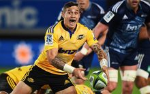 Hurricanes halfback TJ Perenara clears a ruck against the Blues