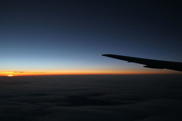 Plane wing at night with sunset (stock)